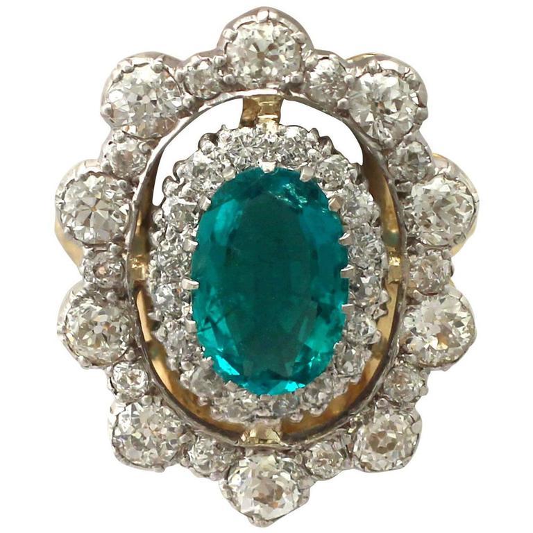 1930s 3.12 Carat Emerald and 3.15 Carat Diamond Yellow Gold Cocktail Ring 1
