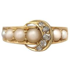 1910s 0.15 Carat Diamond and Pearl, 18 Carat Yellow Gold 'Buckle' Ring