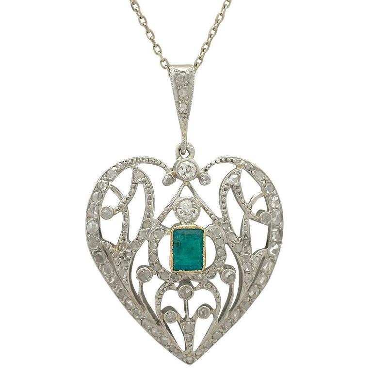 Antique 1890s 0.33 ct Emerald and 0.35 ct Diamond, 9 k White Gold Heart Pendant