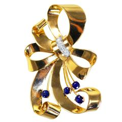1940s Tiffany & Co. Sapphire Diamond Gold and Platinum Bow Brooch