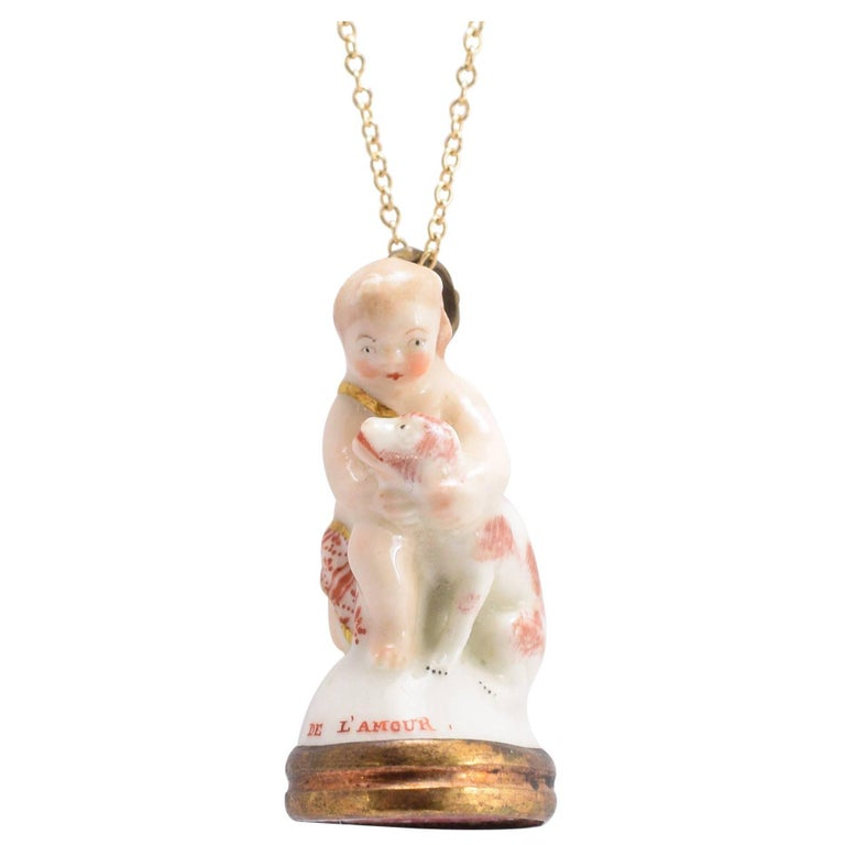 """18th Century Derby Chelsea Porcelain """"Cupid Caressing Dog"""" Fob Pendant"""