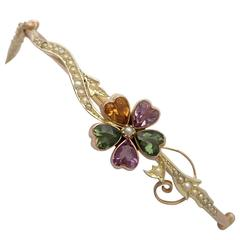Victorian Amethyst, Citrine, Tourmaline, and Seed Pearl Yellow Gold Bangle