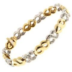 Pave Diamond Yellow And White Gold Swirl Link Bracelet