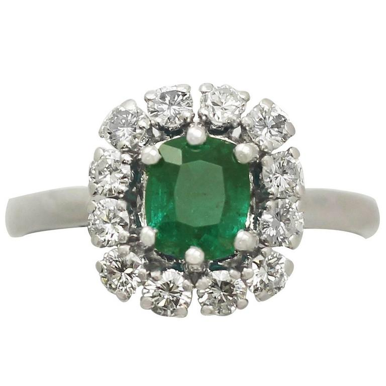 1980s 1.33 Carat Emerald and Diamond White Gold Cluster Ring
