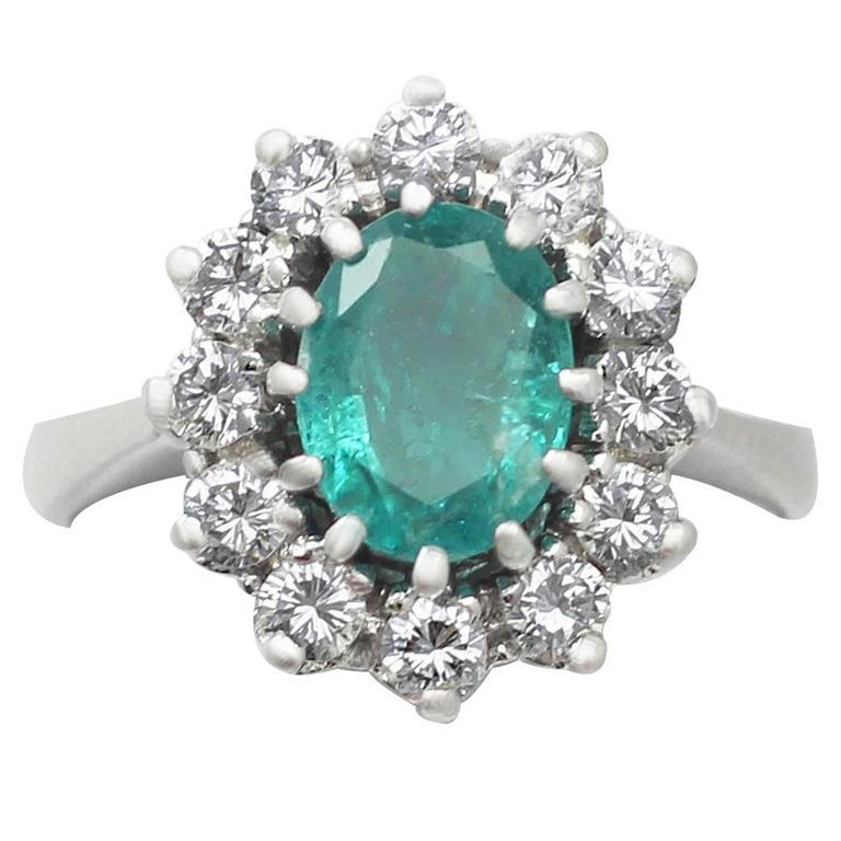 1970s 1.50 Carat Emerald and 1.12 Carat Diamond White Gold Cluster Ring