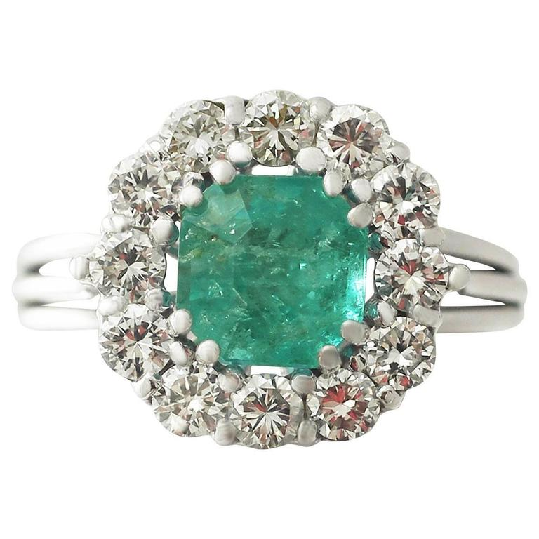 1.94Ct Emerald and 0.95Ct Diamond 18k White Gold Cluster Ring, circa 1980