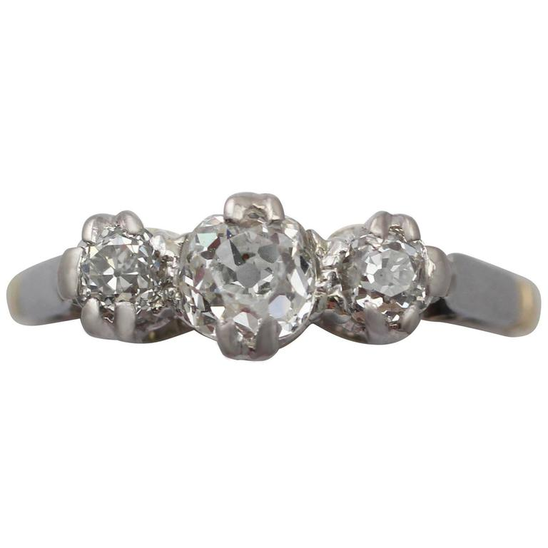 0.88 Carat Diamond and 18 Karat Yellow Gold Three-Stone Ring, Antique circa 1920