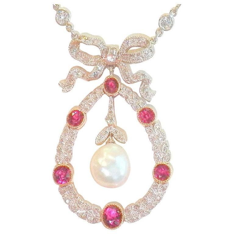 Edwardian Natural Pearl Ruby Diamond Platinum Pendant