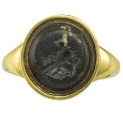 An Antique Gold and Black Hardstone Greco-Roman Intaglio Ring
