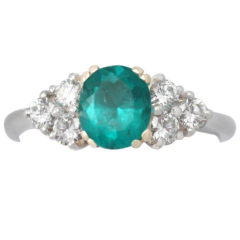 1990s 1.06 Carat Emerald and Diamond Platinum Cocktail Ring 1