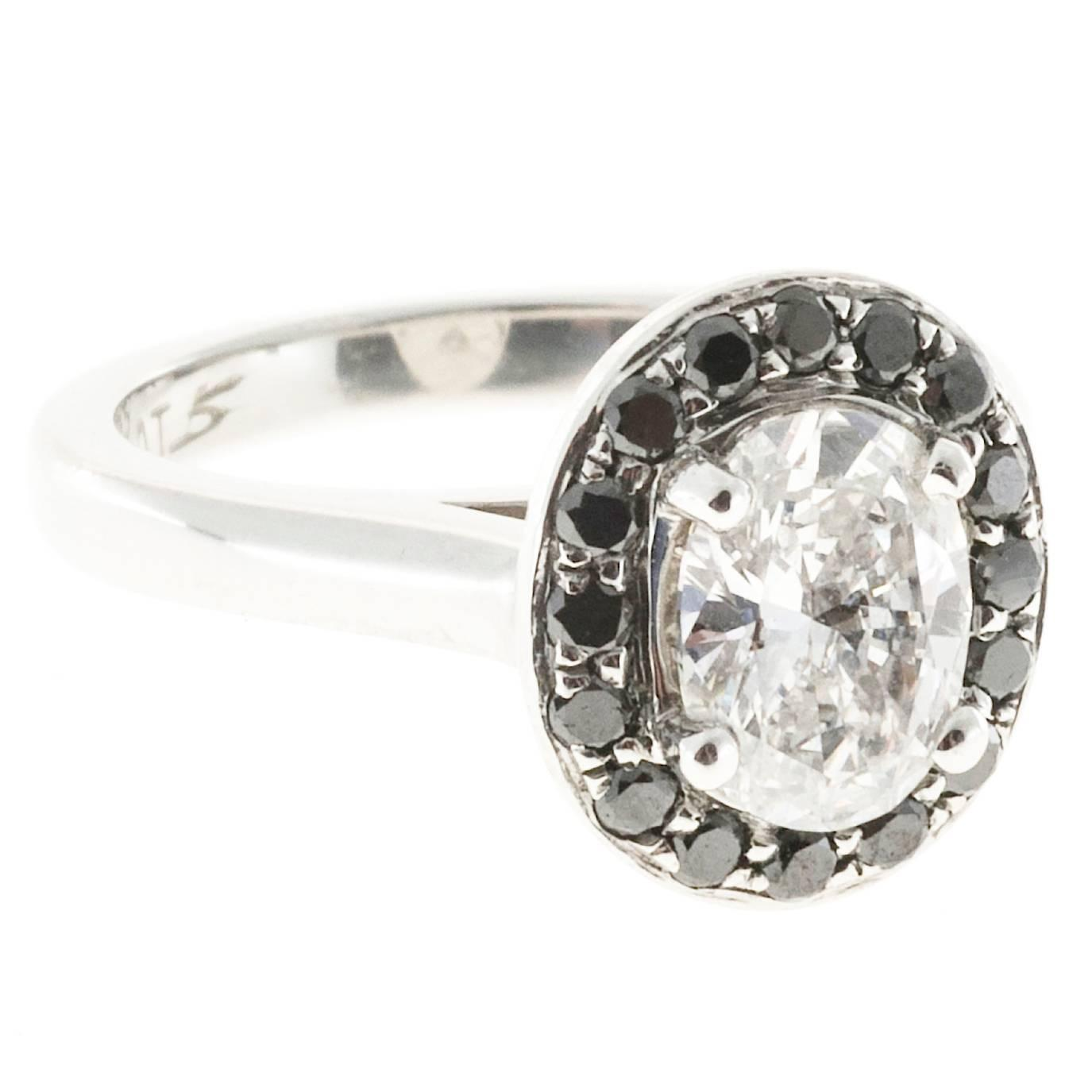 Oval Diamond And Black Diamond Halo Platinum Ring For Sale at 1stdibs
