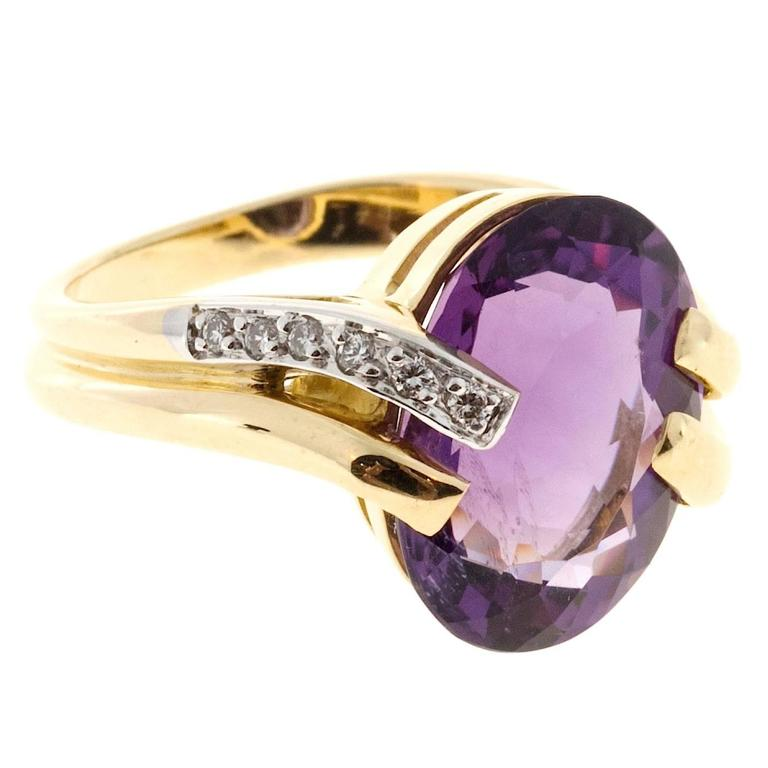 Oval Amethyst and Diamond Gold Swirl Ring