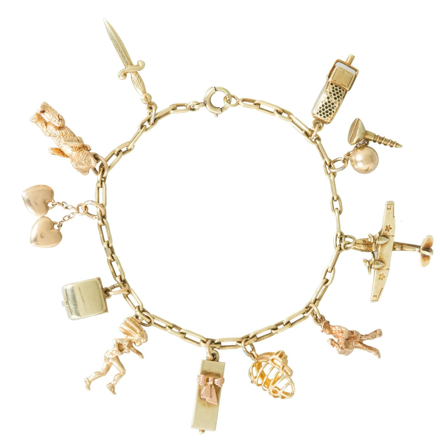 Gold Charm Bracelet with Mechanical Moving Charms at 1stdibs