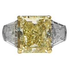 Eiseman 8.01 Carat Fancy Yellow Diamond 2.80 carats Accented Three Stone Ring
