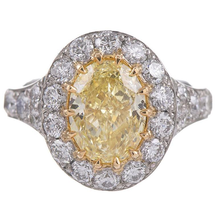 2 65 Carat Fancy Yellow Oval Diamond Gold Platinum Cluster Ring at 1stdibs