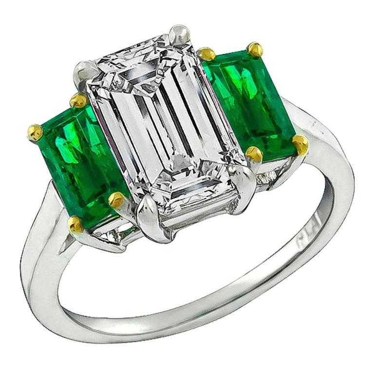 2.27 Carat Emerald Cut Diamond Emerald Platinum Engagement Ring For Sale