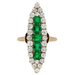 Antique marquise shape emerald and diamond ring, circa 1900.