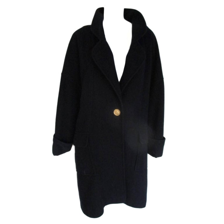 Chanel blue wool coat with signature coco buttons