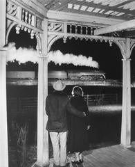 Mr. and Mrs. Ben Pope watch the last steam powered passenger train