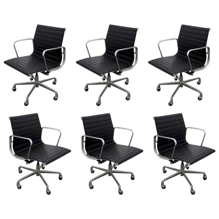 six vintage eames aluminum group leather management chairs for