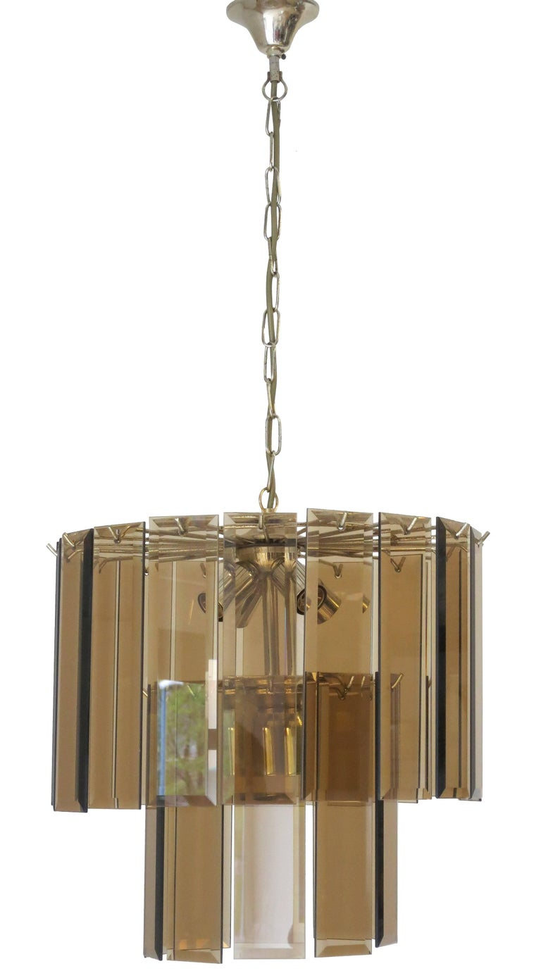 Original vintage Italian pendant with smoky beveled glasses mounted on brass frame / Designed by Cristal Arte circa 1960's / Made in Italy  5 lights / four E12 type,  one E26 type / max 40W each Diameter: 15.75 inches / Height: 15.75 inches 1 in