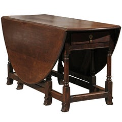 English 1780s Georgian Drop-Leaf Gateleg Table with Oval Top and Turned Base