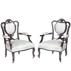 Pair of Victorian Carved Black Lacquered Library Chairs