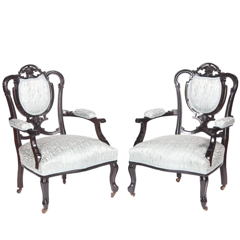 Pair of Victorian Carved Black Lacquered Library Chairs For Sale