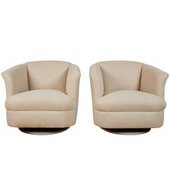 Pair of Rocking and Swivelling Club Chairs
