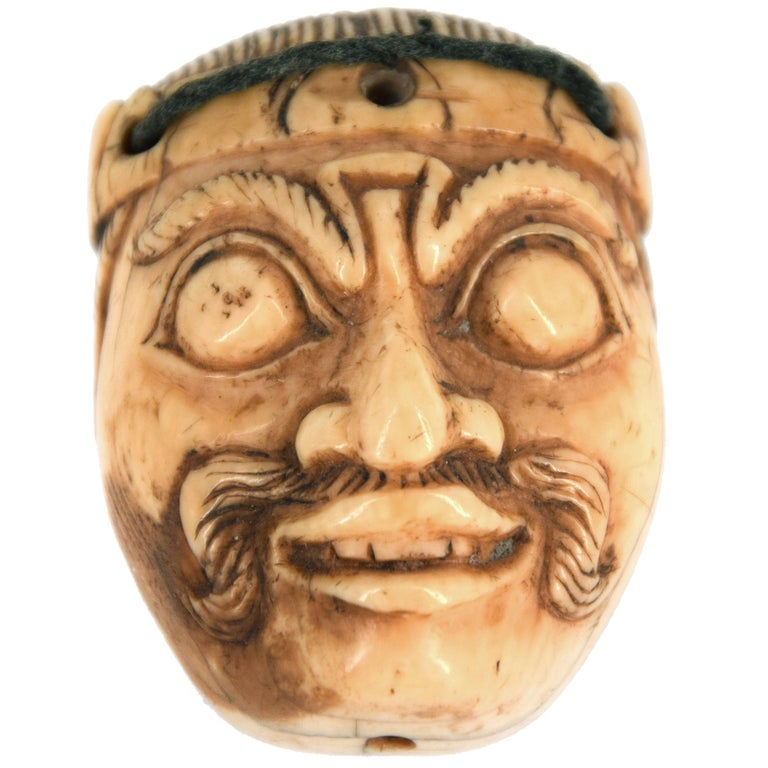 Small Indonesian Mask in Ivory For Sale