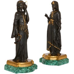 Pair of Egyptian Revival Patinated Bronze Figures