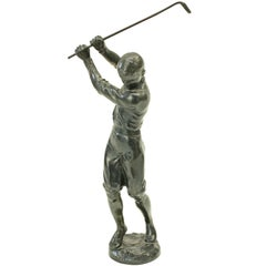Bronzed Statue of a Boy Golfer