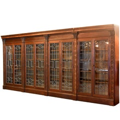 Ornately Carved Oak Bookcase with Leaded Glass Doors