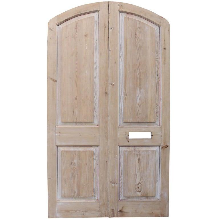 Pair of Antique Arched Pine Exterior Doors