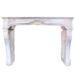 Late 18th Century French Limestone Fireplace