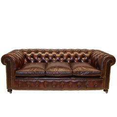 Antique Tan Chesterfield Sofa with Brass Castors / Wheels