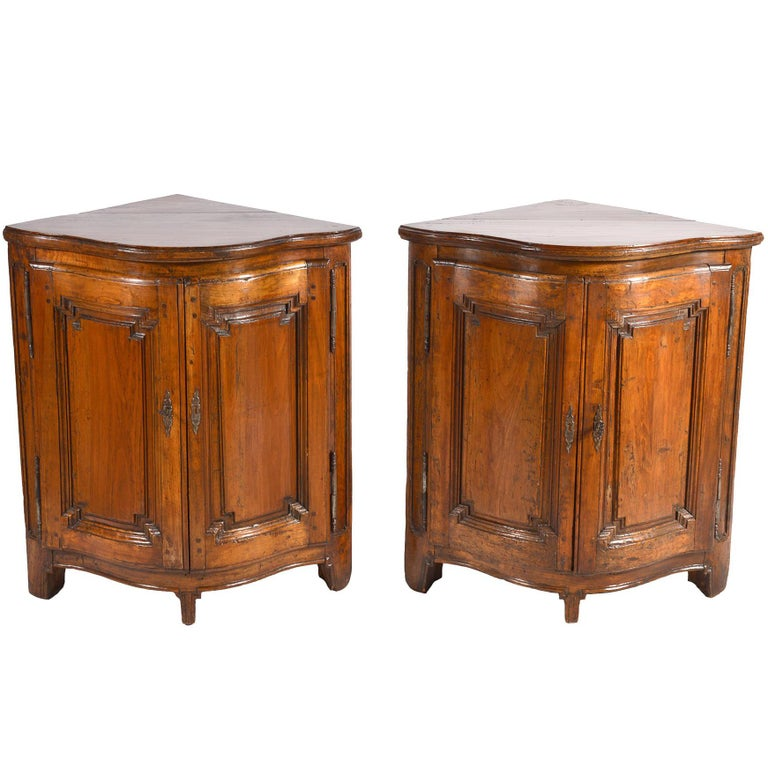 Pair of Early 19th Century Carved French Provincial Serpentine Corner Cabinets For Sale