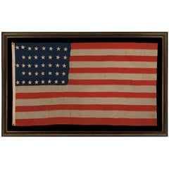 "38 Hand-Sewn Stars In A ""Notched"" Pattern on an Antique American Flag"