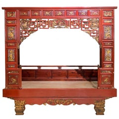 Late 19th Century Red and Gold Carved Ladies Bed