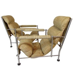 Warren McArthur Stainless Steel Lounge Chairs and Ottoman, circa 1935-1936, Pair
