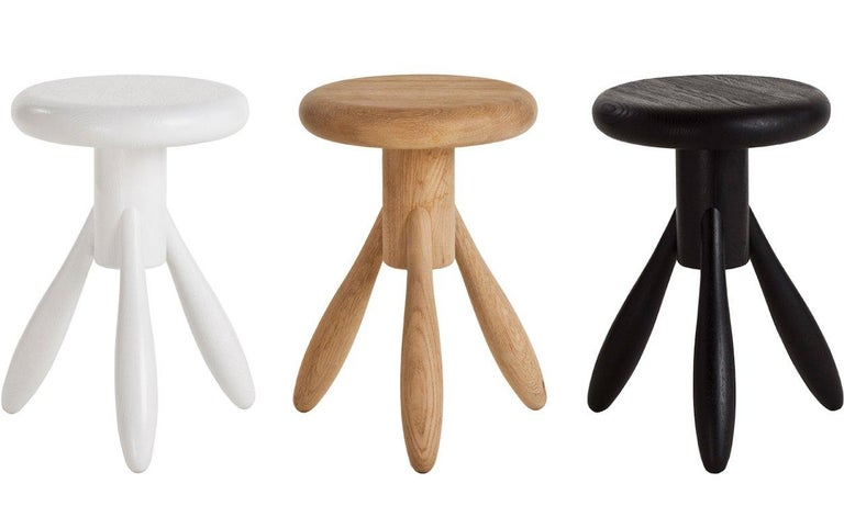 Authentic baby rocket stool in oak with white lacquer by Eero Aarino & Artek. Crafted in solid oak and originally created for finnish designer Eero Aarnio's home kitchen, the bar stool has proved very popular since its introduction by Artek. Aarnio