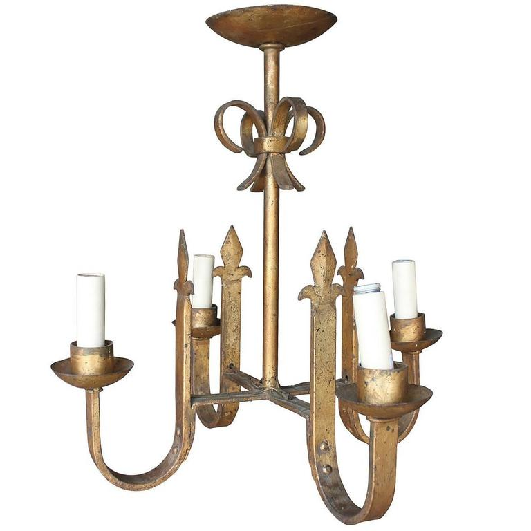 Vintage Gilt Iron Four-Arm Chandelier 1