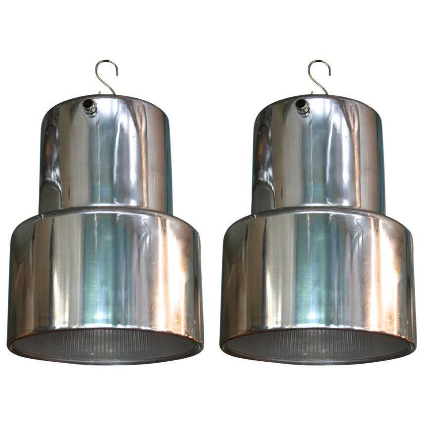 Polished Aluminum and Industrial Era Glass Pendant Lights