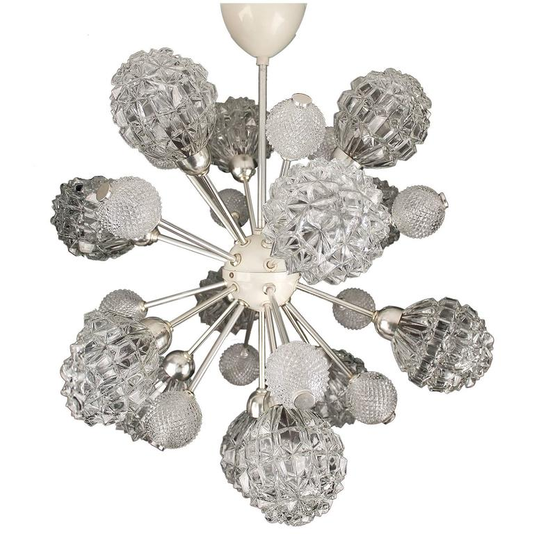 Large Sputnik / sunburst  Chandelier with 24 glass globes (12 large and 12 small)  Dimensions 28.74 in.H / 73 cmH Diameter 28.74 in. (73 cm)  Height indicated is total height with pole  12 standard bulbs, 40 watts each - LED compatible