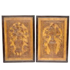 Pair of Asiatic style wood panels bas-relief, late 19th century