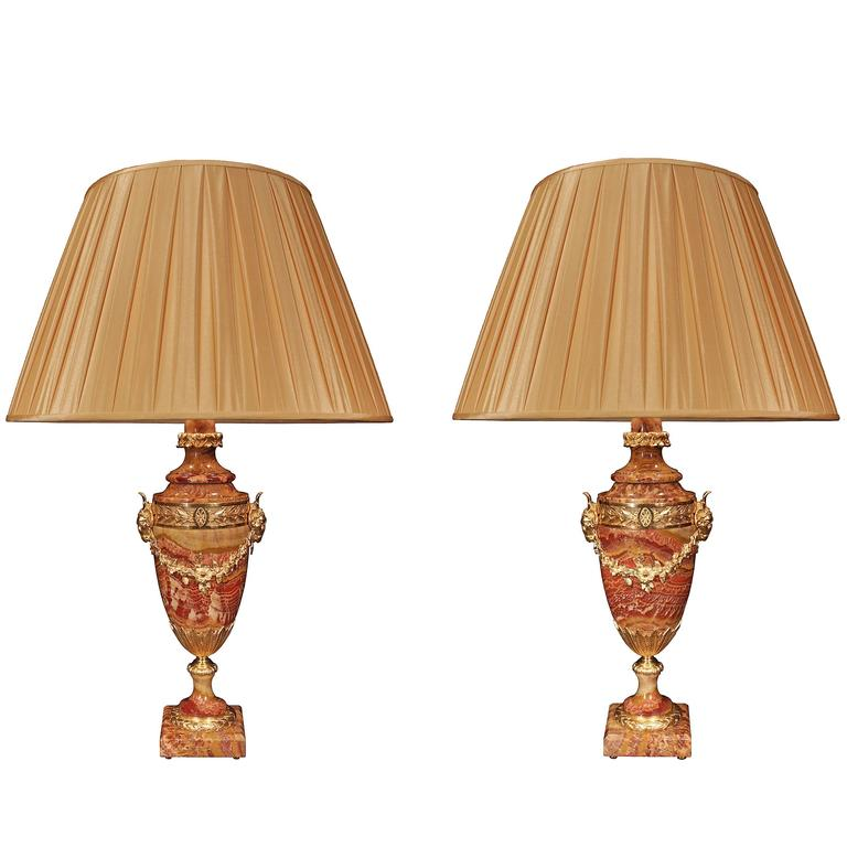 Pair of French 19th Century Louis XVI Style Red Vulcano Onyx and Ormolu Lamps