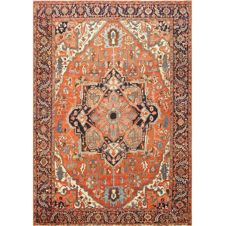 Antique Tribal Room Size Persian Heriz Serapi Rug For
