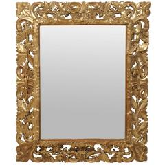 19th Century French Gilded Mirror with Carved Frame