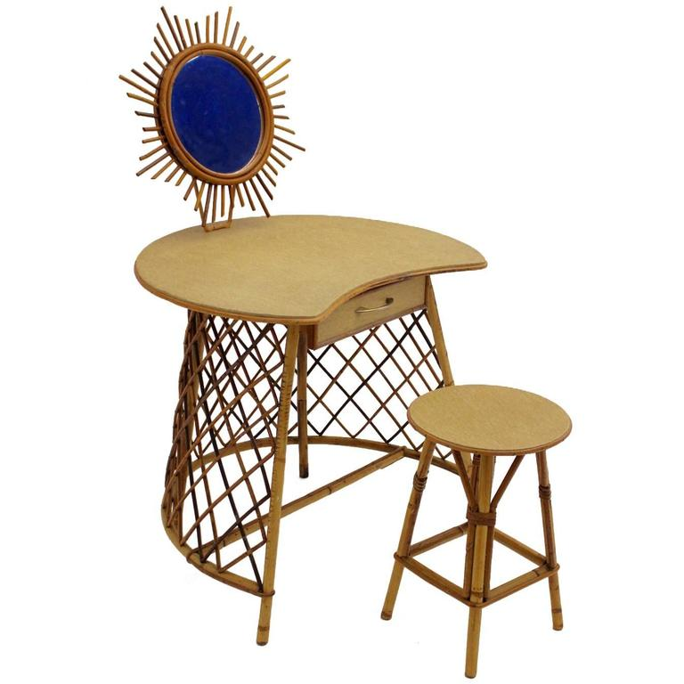 Vanity with a sunburst mirror in the Style of Jean Royere, 1950s Rattan For Sale