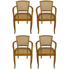 Four Classic Cherrywood and Cane Armchairs in the Style of Baker